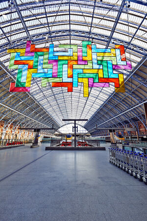 LONDON - JUNE 8.  Restored and redeveloped St Pancras International rail station and the Chromolocomotion by David Batchelor; June 7, 2014 in London, UK.