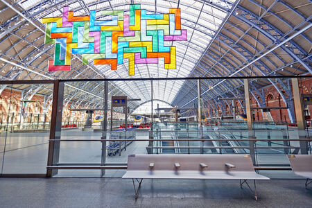 LONDON - JUNE 8.  Restored and redeveloped St Pancras International rail station and the Chromolocomotion by David Batchelor; June 8, 2014 in London, UK. Editorial