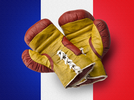 Old red and Yellow boxe gloves on French flag photo