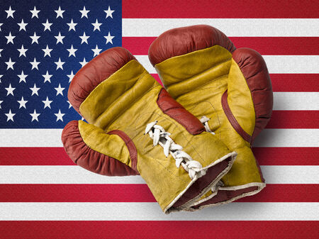 Old red and Yellow boxe gloves on USA flag photo