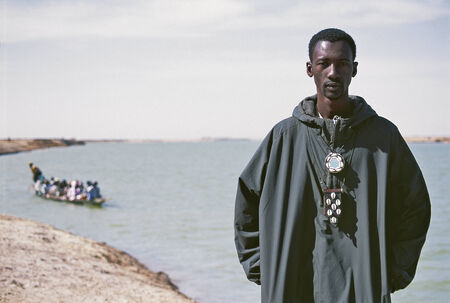 MOPTI, MALI - SEPTEMBER 23, 2009: Portrait of a young African man along the Niger River on September 23, 2009 in Mopti, Mali.