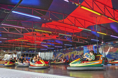 BRUSSELS, BELGIUM - JULY 27, 2014: Some people having fun to drive a bumper car in the amusement park on july 27, 2014 in Brussels, Belgium 2014