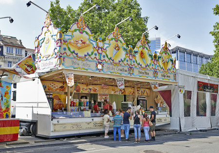 shopping binge: BRUSSELS, BELGIUM - JULY 27, 2014: Food stall selling the famous Belgian chips in the biggest fun fair in Brussels on 20 july, 2014.People make queue and wait for their turn. Editorial