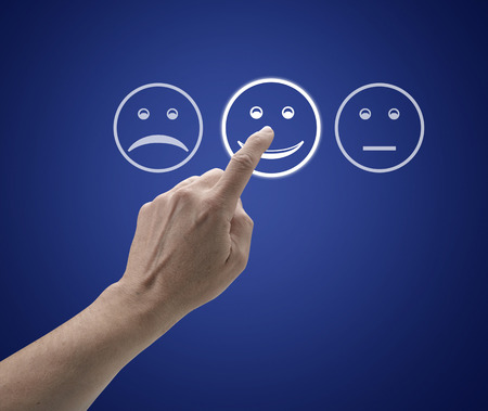 Hand touching screen with customer service evaluation form. Stock Photo