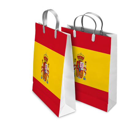 Two Shopping Bags opened and closed with Spain flag isolated on white. There is a different path for each bag photo