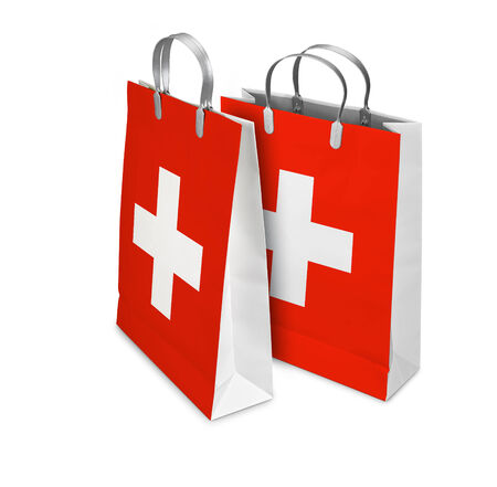 opened bag: Two Shopping Bags opened and closed with Switzerland flag isolated on white. There is a different path for each bag