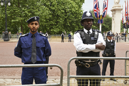 LONDON, ENGLAND - June 07, 2014: Heavily armed police officers on Guard near Buckingham Palace, London for Trooping the Colour in London, England the 07 june 2014