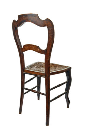 cane chair: Antique wooden chair with cane isolated on white - 34 back view