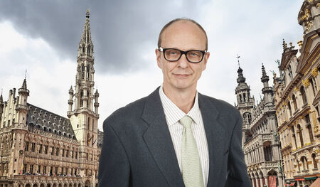 50 to 55 years: Senior Business Man at Grand Place, Brussels, Europe
