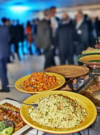 willingness: Catering service with lot of blurred people in background Stock Photo