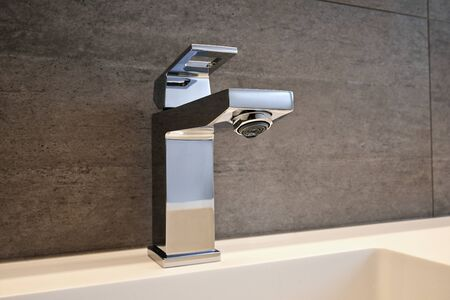 household fixture: Very high end faucet, sink, and counter in a luxury bathroom - no water