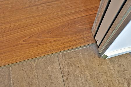 hardwood floor: Marble and hardwood floor between door Stock Photo