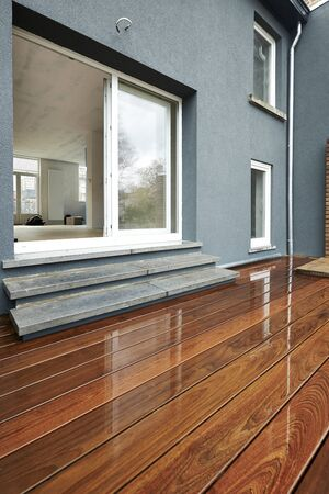 wet floor: Wet Outdoor Wood Surface in front of a renovated wall
