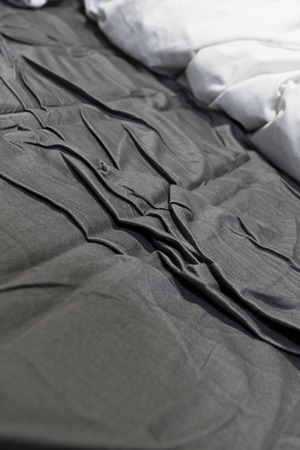 disheveled: Disheveled sheets and pillows year of unmade bed Stock Photo