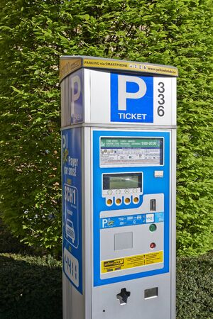 parking spaces: BRUSSELS, BELGIUM - APRIL 15, 2015: Brussels powered solar parking meter. Parking solutions have been growing in importance to deal with increasing congestion of parking spaces. Editorial