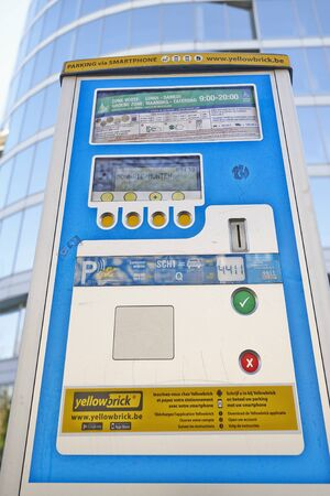 parking spaces: BRUSSELS, BELGIUM - APRIL 15, 2015:  Brussels powered solar parking meter. Parking solutions have been growing in importance to deal with increasing congestion of parking spaces.