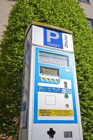 made in belgium: BRUSSELS, BELGIUM - APRIL 15, 2015:  Brussels powered solar parking meter. Parking solutions have been growing in importance to deal with increasing congestion of parking spaces.