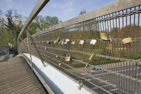 sovereign: Love padlocks on the bridge on the Tervueren avenue in Brussels, Belgium. This metal pedestrian bridge overcomes the Avenue de Tervuren, the Sovereign boulevard and the Museum of Urban Transport of Brussels.