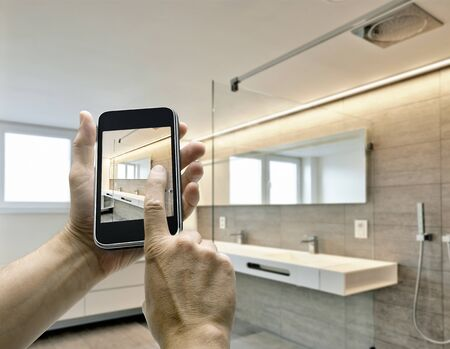 global technology: Mobile device with man hands taking picture in luxury Bathroom