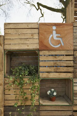 female likeness: Disabled person toilet directions sign for outdoor public toilets