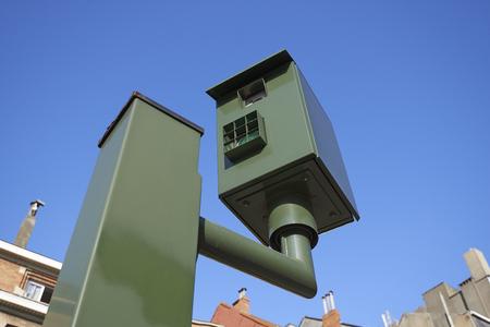 Belgium speed camera against clear blue sky photo