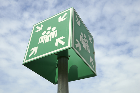 to gather: Meeting or assembly point sign on blue sky