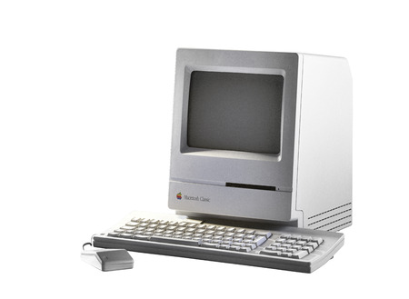 BRUSSEL,BELGIUM - CIRCA YEAR: Old Fashioned Computer and Mouse on Office Desk. Model Apple Macintosh Classic from 1990. Isolated on white with clipping path 에디토리얼