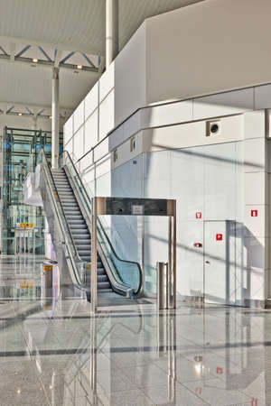 staff only: BRUSSELS, BELGIUM- JUNE 07, 2015: Escalator for staff only in the main hall from the Zaventem airport in Brussels Editorial