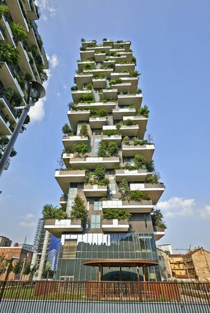 bosco: MILAN, ITALY- JUNE 11, 2015: Vertical Forest apartment building in the Porta Nuova area of Milano, Lombardy, Italy also called Bosco Verticale and winner for 2014 of the International Highrise Award, organized by Deutsches Architekturmuseum of Frankfurt Editorial