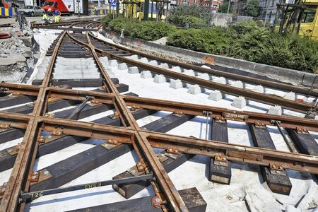 ours: BRUSSELS, BELGIUM -16 JULY 2015: Some workers repair and replace rail trams in Brussels at Verboekhoven square in Schaerbeek.
