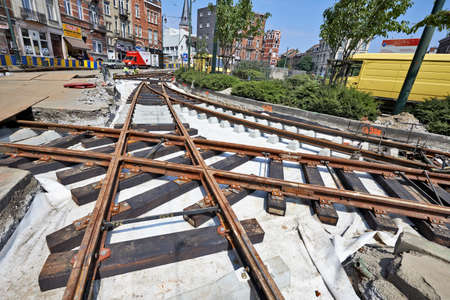 BRUSSELS, BELGIUM -16 JULY 2015: Some workers repair and replace rail trams in Brussels at Verboekhoven square in Schaerbeek.