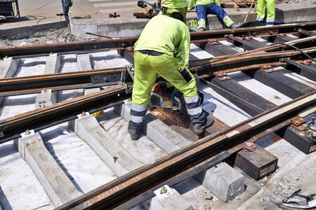 ours: BRUSSELS, BELGIUM -16 JULY 2015: Some workers repair and replace some rail trams in Brussels at Verboekhoven square in Schaerbeek.