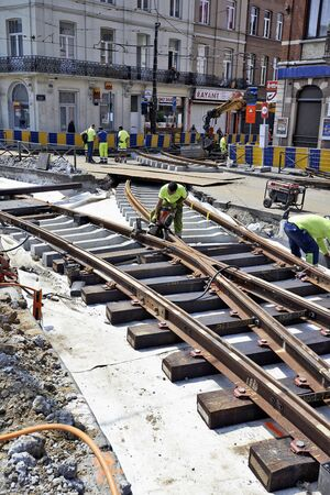 BRUSSELS, BELGIUM -16 JULY 2015: Some workers repair and replace some rail trams in Brussels at Verboekhoven square in Schaerbeek.