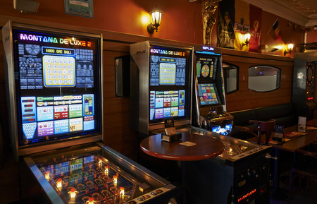 montane: BRUSSELS, BELGIUM -18 JULY 2015: Typical cafe bar in the heart of Brussels with its slot machines and its football decorations