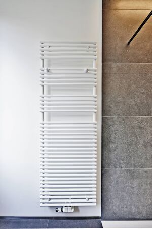 white metal: modern white towel rail mounted on wall
