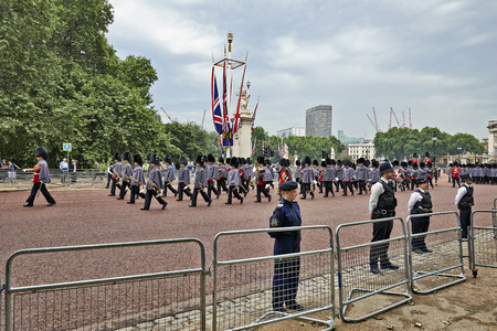 buckingham palace: LONDON, ENGLAND - JUNE 07, 2014: Heavily armed police officers on Guard near Buckingham Palace, London for Trooping the Colour in London, England the 07 june 2014