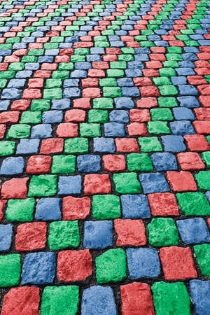 cobbled: Red green blue colored cobbled road
