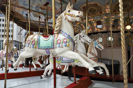 Classic carousel horse, Focus on three horses. Stock Photo
