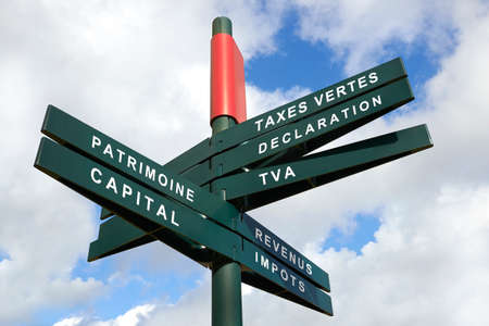 multidirectional: Tax Shift Signpost against cloudy sky, French words - clipping path for isolated the panels