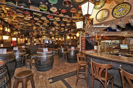 guinness beer: BRUSSELS, BELGIUM - OCTOBER 05, 2015:  Delirium Cafe known for its long beer list, standing at 2.004 different brands in January 2004 as recorded in the The Guinness Book of Records. Editorial