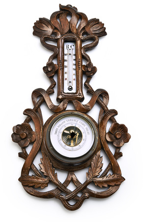 aneroid: Traditional wooden barometer and thermometer isolated on a white background - clipping path