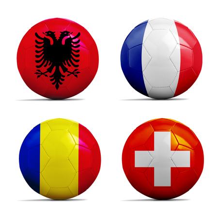 Vier Fußbälle mit Gruppe A-Team-Flaggen, Fußball-Europameisterschaft 2016. Lizenzfreie Bilder