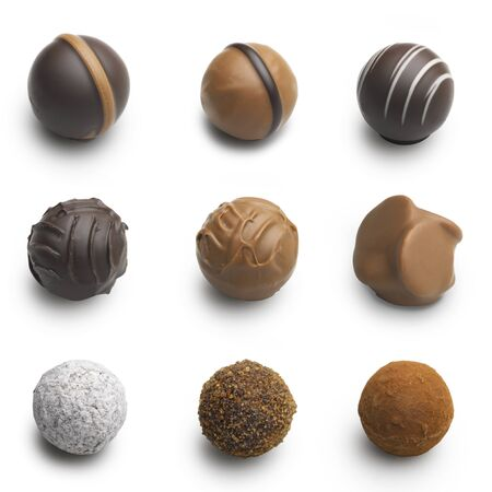 isolated on yellow: chocolate truffles assortment isolated on white Stock Photo