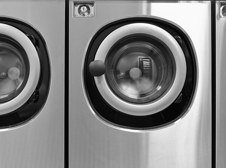 laundrette: Industrial washing machines in a public  from front Stock Photo
