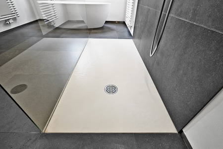Corian floor and drain from modern shower in luxury bathroom
