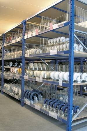 storage bin: Shelves and racks in distribution storehouse interior.