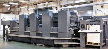 publishes: Offset printer press in industry plant Stock Photo