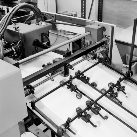 out of production: Detail shot in Black and white of the workings of a printing factory.