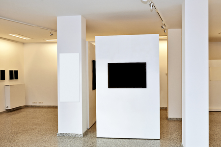 paintings art: exhibition gallery, wall mounted art with museum style lighting, the art has been removed and replaced. There are path for the frame