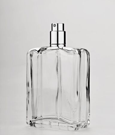 spray bottle: Close-up of a perfume spray bottle on gray background